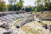 The Roman Amphitheatre Of Syracuse - Ruins In Archeological Park, Sicily, Italy poster