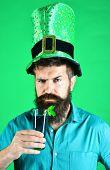 St Patricks Green Shamrock Floating In Beer. Green Hat With Clover. Bearded Leprechaun Holds Green B poster
