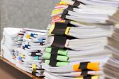 Pile Of Unfinished Document On Office Desk. Stack Of Homework Assignment Archive With Colorful Paper poster