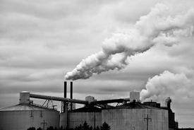 foto of stewardship  - Factory spews smoke into a dark and stormy sky - JPG
