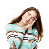 picture of have sweet dreams  - Young beautiful girl pretend sleeping and having sweet dreams - JPG