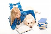 Girl Reading A Book With Labrador Retriever On Isolated White