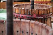 pic of wine-press  - Color detail of a wine manual grape crushing machine - JPG