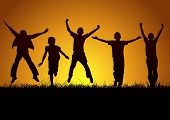 stock photo of glory  - Little happy children silhouettes in the nature at sunset - JPG