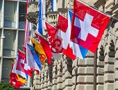 picture of zurich  - Ancient Paradenplatz square in Zurich decorated with swiss flags - JPG