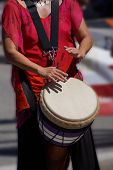 pic of penticton  - Close up of drumming by woman in bright clothes Penticton British Columbia Canada - JPG