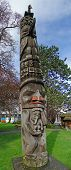 image of indian totem pole  - Totem pole carved from cedar Thunderbird Park Victoria BC Canada - JPG