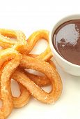 stock photo of churros  - Traditional spanish churros donuts with thick hot chocolate in a cup - JPG