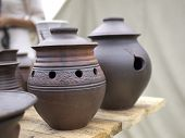 stock photo of loam  - The handmade Loam pots in Moscow art festival - JPG