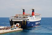 ALONISSOS, GREECE - JUNE 26: Hellenic Seaways ferry Express Pegasus unloading at Patitiri harbour on
