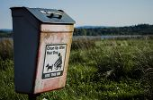 foto of dog poop  - clean up after your dog weathered bin