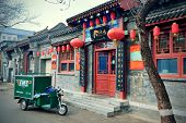 BEIJING, CHINA - APR 4: Old street view with stores on April 4, 2013 in Beijing, China. Beijing is t