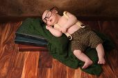 stock photo of suspenders  - Ten day old newborn baby boy wearing crocheted shorts and suspenders - JPG