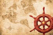 image of ship steering wheel  - steering wheel with a navigator and lighthouse - JPG