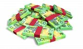 stock photo of bundle money  - A pile of randomly scattered wads of australian dollar banknotes on an isolated background - JPG