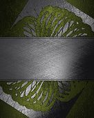 Green texture with abstract pattern and metal nameplate