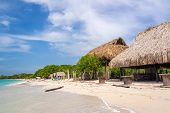 stock photo of beach hut  - Simple beach huts on beach at Playa Blanca near Cartagena Colombia - JPG