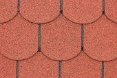 picture of shingles  - A macro of red asphalt shingle as background - JPG