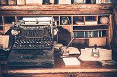 stock photo of typewriter  - Old Desk with Vintage Typewriter - JPG