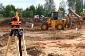 stock photo of theodolite  - Using theodolite at construction site for land level measurement - JPG
