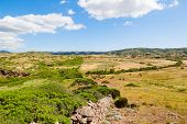 picture of old stone fence  - Menorca island field landscape with old traditional masonry fence - JPG