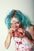 stock photo of gothic female  - A genuine Female Zombie enjoys eating a Fresh Brain from her latest Victim - JPG