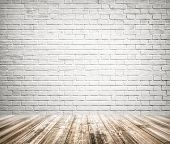 stock photo of wall-stone  - Background of age grungy texture white brick and stone wall with light wooden floor with whiteboard inside old modern and contemporary empty interior - JPG