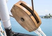 stock photo of pulley  - the big Wooden pulley with ropes on deck - JPG
