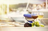 foto of bollard  - Pair of wineglasses and grapes against yachts in La Spezia - JPG