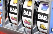 foto of coin slot  - Detail of Three bar jackpot on slot machine - JPG
