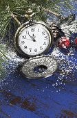 picture of midnight  - Happy New Year pocket fob watch with five to midnight time and decorations on dark blue rustic distressed vintage wood - JPG