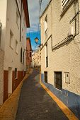 image of costa blanca  - Narrow uphill street in one of the many charming mountain villages on Costa Blanca - JPG