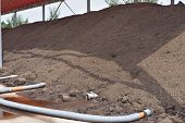 foto of aeration  - Industrial compost heap with forced aeration pipes - JPG