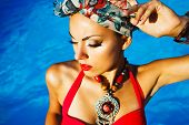 pic of turban  - Beautiful fashionable woman near the pool wearing colored turban - JPG
