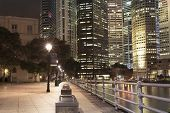 stock photo of singapore night  - night illumination on river embankment in Singapore downtown - JPG