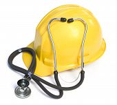 stock photo of osha  - Hart hat and stethescope on a white background - JPG