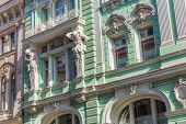 image of neoclassical  - Beautiful neoclassic facade with atlants of the house on Iliynka street in Moscow old town Russia - JPG