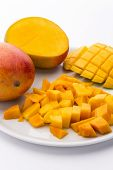 picture of mango  - Heap of freshly cut mango pulp cubes on a plate - JPG