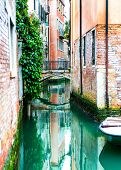 stock photo of tenement  - Canal and historic tenements - JPG