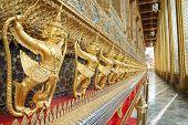 stock photo of glorify  - The statue garuda fairy tale animal of thai buddhist native on the temple wall at wat prakeaw temple in bangkok province - JPG