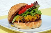 stock photo of bap  - Vegetarian chickpea sweetcorn and carrot burger with salad in a sesame seed bun UK - JPG
