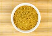 picture of flaxseeds  - Top view of ground flaxseed powder on wood background - JPG