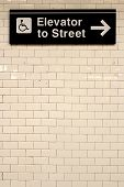 foto of directional  - New York City Station subway directional sign on tile wall - JPG