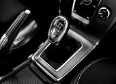 foto of gear-shifter  - Closeup photo of car gearbox in bright light - JPG