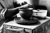 stock photo of molding clay  - Pottery Craft Ceramic Clay In Potter Human Hand - JPG