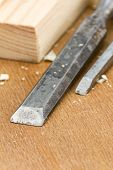 pic of chisel  - Used carpenter wood chisels tool with planks and shavings - JPG