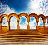 image of stairway  - Yellow stairway to heaven with column cloisters in bright sky - JPG