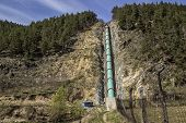 image of hydroelectric  - Hydroelectric pipe ( under construction ) in mountainous area