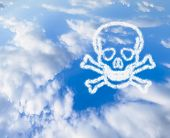 stock photo of skull crossbones  - the blue sky with the symbol of the skull and crossbones from the cloud - JPG