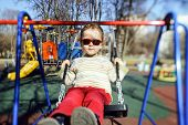 pic of seesaw  - Cute little girl swinging on seesaw on children playground - JPG